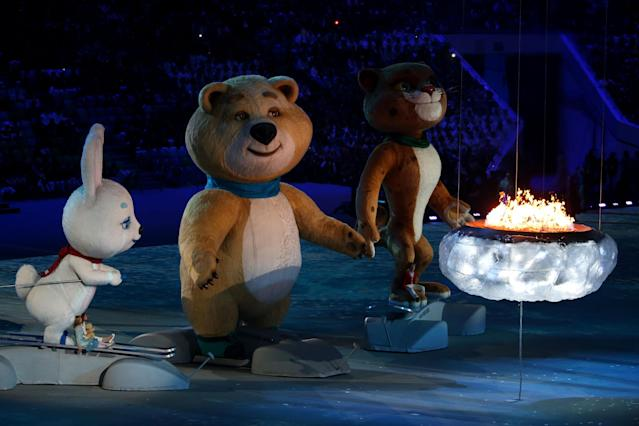 SOCHI, RUSSIA - FEBRUARY 23: Olympic mascots the Hare, the Polar Bear and the Leopard stand by the Olympic flame during the 2014 Sochi Winter Olympics Closing Ceremony at Fisht Olympic Stadium on February 23, 2014 in Sochi, Russia. (Photo by Quinn Rooney/Getty Images)