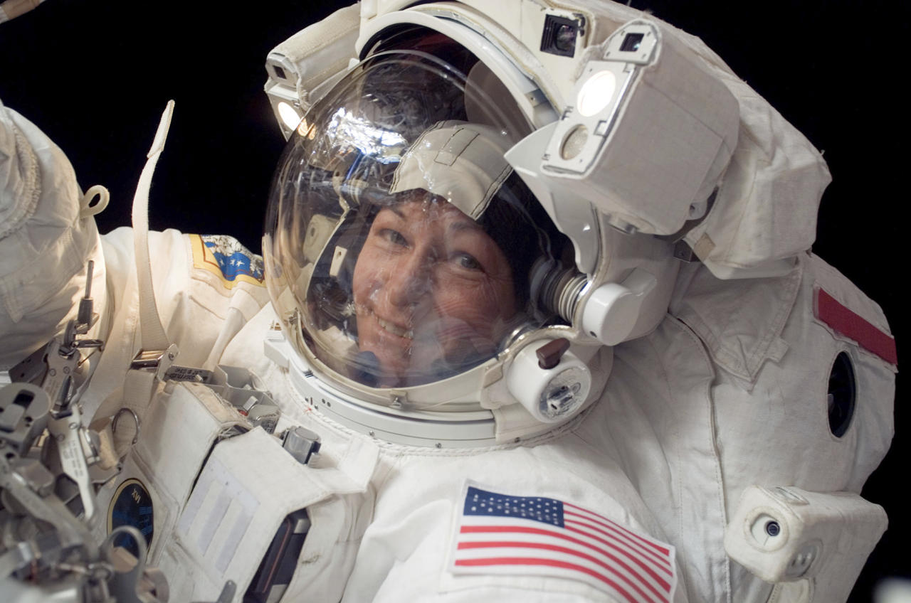In this Jan. 30, 2008 photo made available by NASA, Expedition 16 commander Peggy Whitson, the first female commander of the International Space Station, participates in a spacewalk. On Friday, June 15, 2018, NASA announced Whitson, who has spent more time off the planet than any other American, has retired. The 58-year-old biochemist joined NASA as a researcher in 1986 and became an astronaut in 1996. Her last spaceflight was in 2017. (NASA via AP)