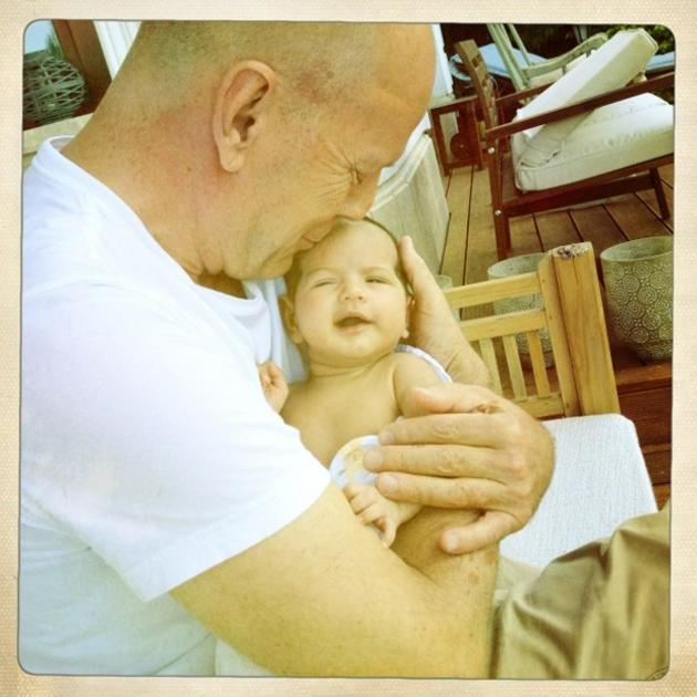 "Celebrity photos: Bruce Willis' wife Emma Heming-Willis tweeted this gorgeous photo of Bruce with their baby, Mabel Ray. Emma captioned the photo: ""A beautiful day in Budapest with the loves of my life. Daddy and Mabel cracking each other up."" She then continued: ""Being a great dad is in his DNA."" Aw!"