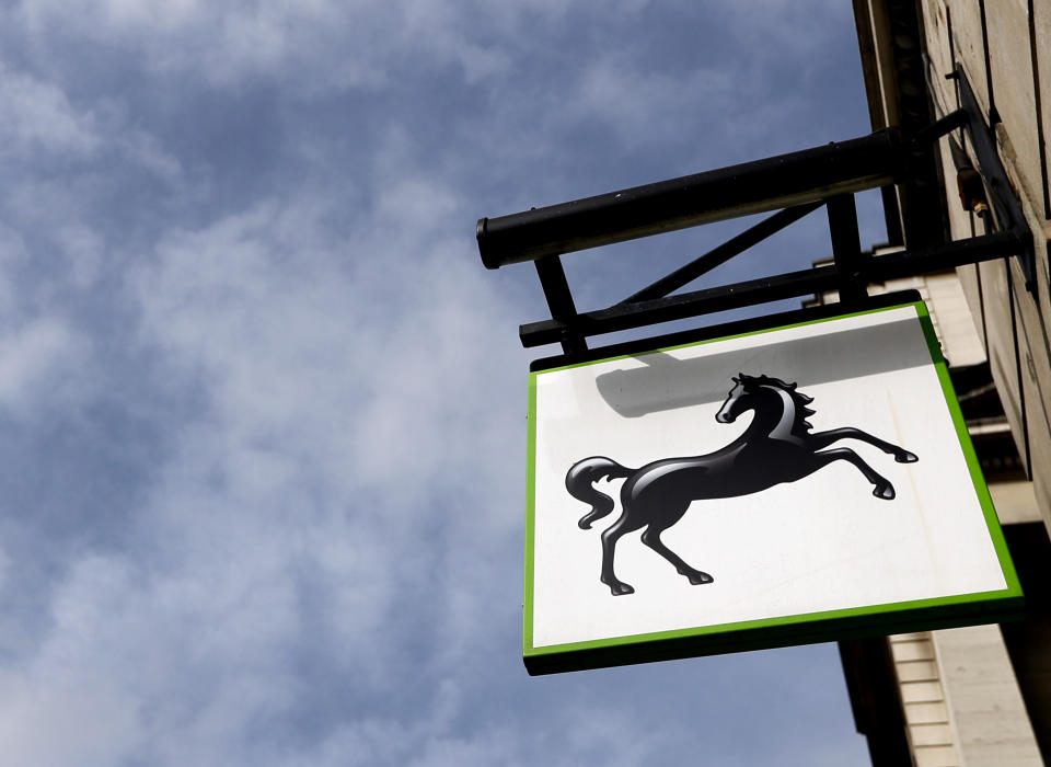 The logo hangs on a branch of Lloyds Bank in London, Thursday, July 28, 2016. Britain's Lloyds Banking Group said Thursday it plans to eliminate 3,000 jobs and close 200 branches — the first big cuts announced since Britain voted to leave the European Union. (AP Photo/Kirsty Wigglesworth)