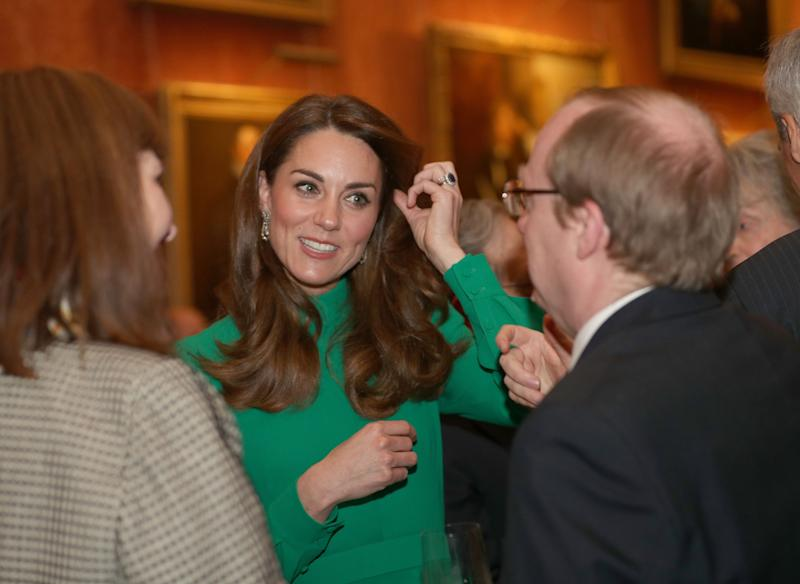 Duchess Kate of Cambridge greets guests at Buckingham Palace during a reception hosted by Queen Elizabeth II for leaders of the NATO alliance summit., Dec. 3, 2019.