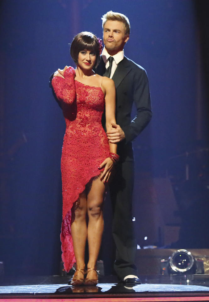 For her Week 9 Argentine tango, Kellie was a lady in red with a brunette wig. She accessorized her angled, red-fringe dress with a red flower in her hair, and the red-hot look helped the star get her first-ever perfect score of 30 points.