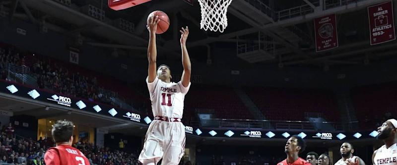 PHILADELPHIA - JANUARY 2: Temple Owls guard Trey Lowe (11) drives in for a lay-up during the American Athletic Conference basketball game January 2, 2016 in Philadelphia.