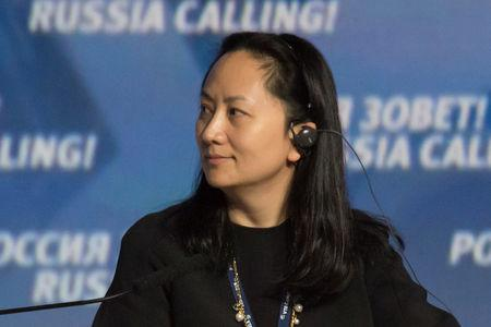 "FILE PHOTO - Meng Wanzhou, Executive Board Director of the Chinese technology giant Huawei, attends a session of the VTB Capital Investment Forum ""Russia Calling!"" in Moscow, Russia October 2, 2014. Picture taken October 2, 2014. REUTERS/Alexander Bibik"
