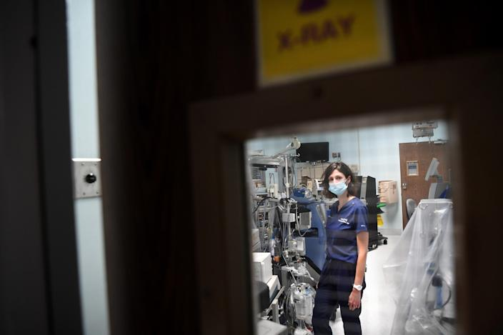 """Dr. Jamie Taylor stands in a room that was converted into an area for COVID patients at Los Angeles Surge Hospital (formerly St. Vincent Medical Center) in Los Angeles. <span class=""""copyright"""">(Wally Skalij/Los Angeles Times)</span>"""