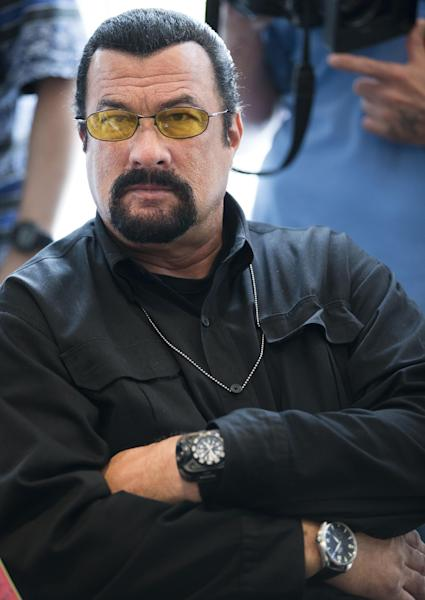 U.S. actor Steven Seagal looks on as he waits for a news conference of U.S. Congressional delegation to Russia in U.S. Embassy in Moscow, Russia, Sunday, June 2, 2013. A U.S. Congressional delegation to Russia learned little about what could have been done to prevent the Boston Marathon bombings, but got to hang out with Steven Seagal. (AP Photo/Alexander Zemlianichenko)