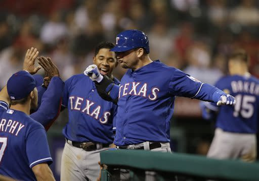 Texas Rangers' A.J. Pierzynski, center, celebrates his home run with teammates during the ninth inning of a baseball game against the Los Angeles Angels in Anaheim, Calif., Monday, April 22, 2013. (AP Photo/Jae C. Hong)