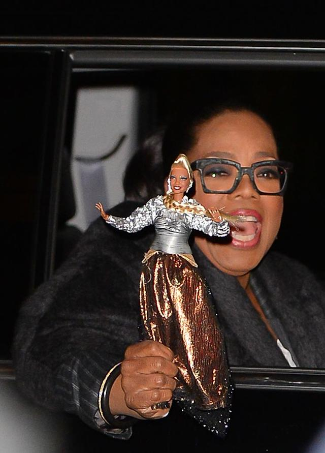 <p>She's just toying with us! The media mogul was seen showing off the doll version of her character from Disney's <em>A Wrinkle in Time</em>, Mrs. Which, after Tuesday night's appearance on <em>Late Show with Stephen Colbert</em> in New York City. (Photo: Raymond Hall/GC Images) </p>