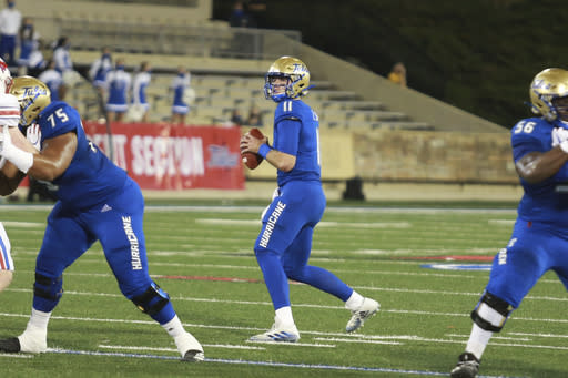 Tulsa quarterback Zach Smith (11) drops back to pass against SMU during the first half of an NCAA college football game in Tulsa, Okla., Saturday, Nov. 14, 2020. (AP Photo/Joey Johnson)