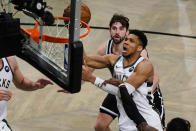 Milwaukee Bucks' Giannis Antetokounmpo, upper right, drives past Brooklyn Nets' Joe Harris during the second half of Game 7 of a second-round NBA basketball playoff series Saturday, June 19, 2021, in New York. (AP Photo/Frank Franklin II)
