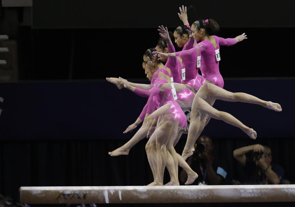 Sabrina Vega performs on the balance beam during the preliminary round of the women's Olympic gymnastics trials, Friday, June 29, 2012, in San Jose, Calif. (AP Photo/Julie Jacobson)