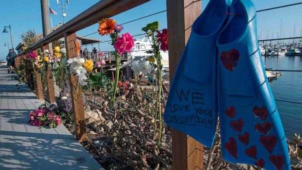 PHOTO: A pair of diving fins and flowers at a memorial wall near the Truth Aquatics moorings where the boat that burned and sank off the Santa Cruz islands, was based in Santa Barbara, Calif., on Sept. 2, 2019. (Mark Ralston/AFP/Getty Images)