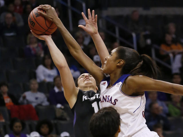 Kansas forward Chelsea Gardner, right, blocks a shot by Kansas State guard Leticia Romero, left, in the second half of a Big 12 women's NCAA college basketball tournament game in Oklahoma City, Friday, March 7, 2014. Kansas won 87-84 in overtime. (AP Photo/Sue Ogrocki)