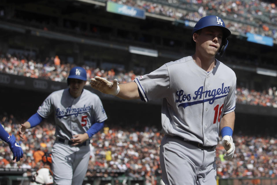 Los Angeles Dodgers' Will Smith, right, celebrates after hitting a two-run home run that also scored Corey Seager, left, during the first inning of a baseball game against the San Francisco Giants in San Francisco, Sunday, Sept. 29, 2019. (AP Photo/Jeff Chiu)
