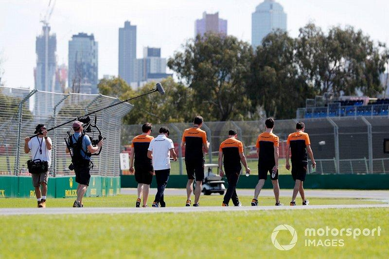 "Members of the McLaren team walk the track<span class=""copyright"">Glenn Dunbar / Motorsport Images</span>"
