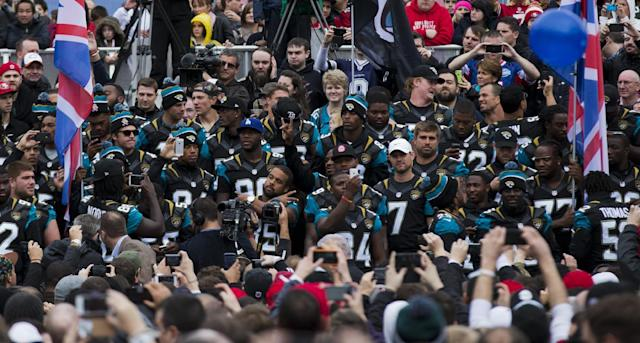 Members of the Jacksonville Jaguars roster stand together after marching out into the crowd during an NFL fan rally in Trafalgar Square, London, Saturday, Oct. 26, 2013. The San Francisco 49ers are due to play the the Jacksonville Jaguars at Wembley stadium in London on Sunday, Oct. 27 in a regular season NFL game. (AP Photo/Matt Dunham)