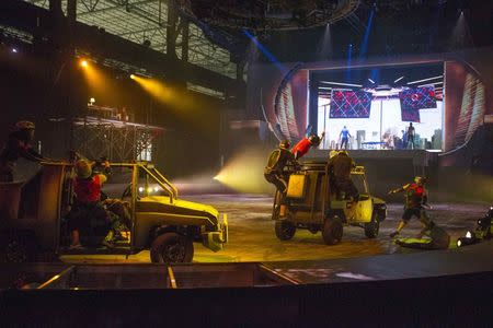 Handout photo of actors rehearing action car chase scene for the new Marvel Universe LIVE! Show