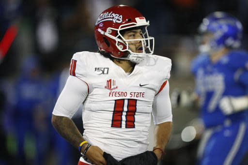 Fresno State quarterback Jorge Reyna heads back to the bench after throwing an interception to Air Force linebacker Kyle Johnson, who scored during the second half of an NCAA college football game Saturday, Oct. 12, 2019, at Air Force Academy, Colo. (AP Photo/David Zalubowski)