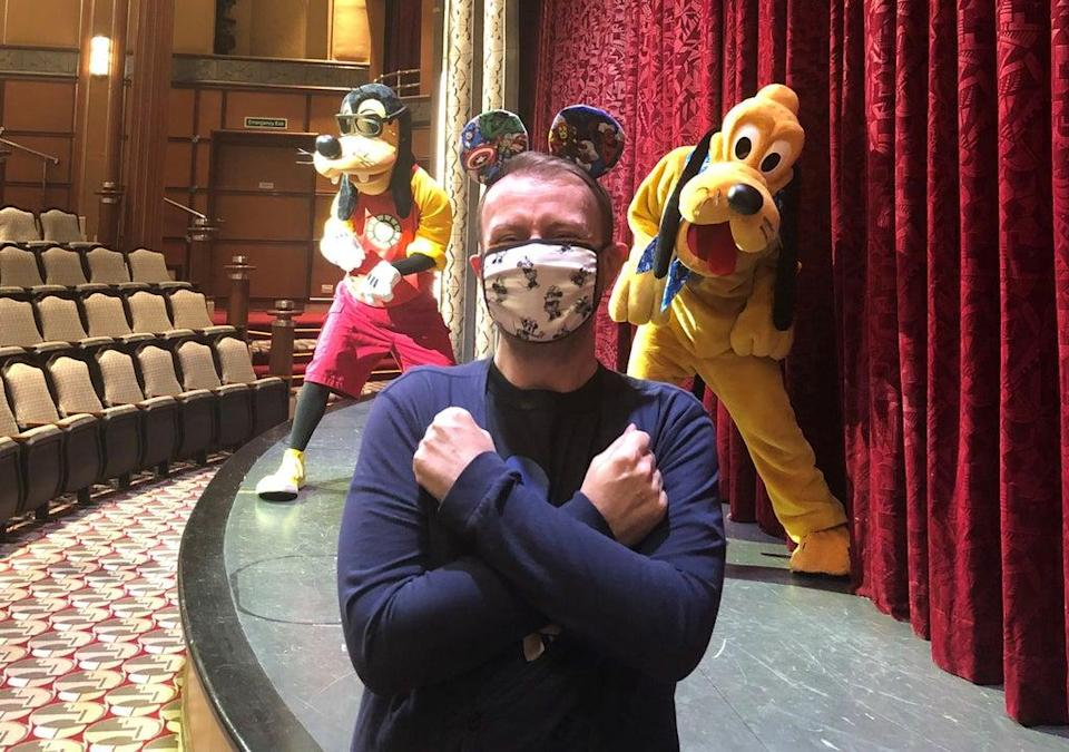 Damon Smith on a selfie spot with Goofy and Pluto in the Buena Vista Theatre of the Disney Magic (PA/Damon Smith)