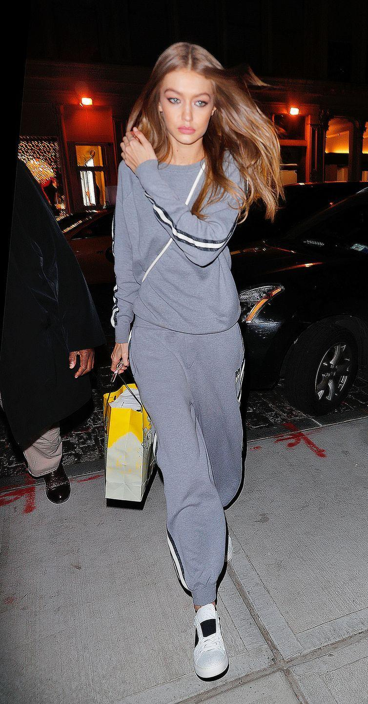 <p>In a grey Olivia von Halle cashmere tracksuit, white crossbody and white M.Gemi sneakers while out in New York.</p>