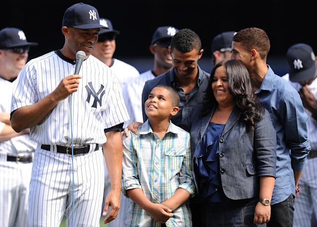 NEW YORK, NY - SEPTEMBER 22: Mariano Rivera #42 of the New York Yankees speaks next to his family during the Mariano Rivera Day pregame ceremony during interleague play on September 22, 2013 at Yankee Stadium in the Bronx borough of New York City. (Photo by Maddie Meyer/Getty Images)