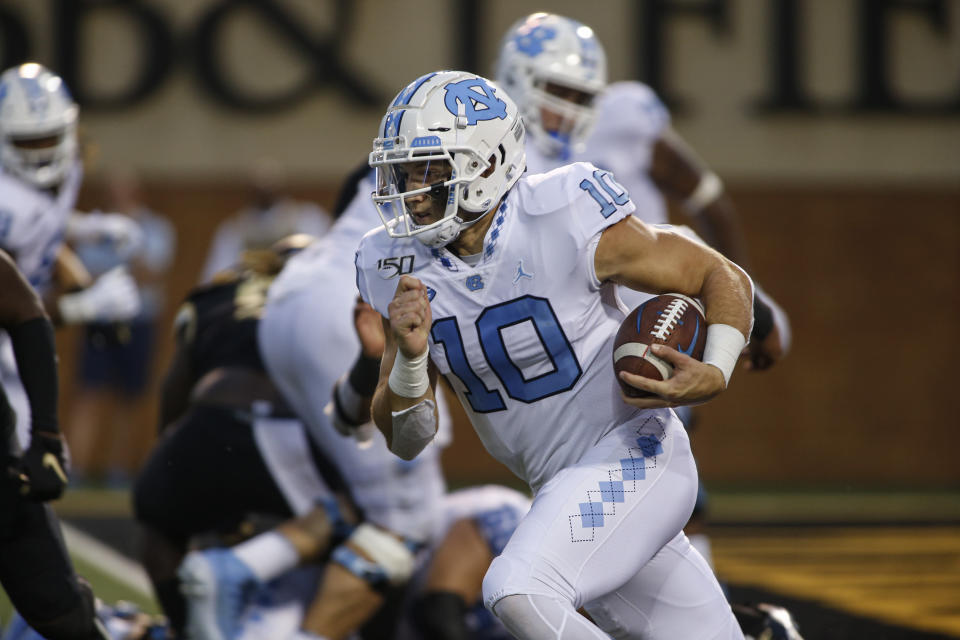 North Carolina quarterback Jace Ruder (10) carries the football against Wake Forest during the first half of an NCAA college football game in Winston-Salem, N.C., Friday, Sept. 13, 2019. (AP Photo/Nell Redmond)