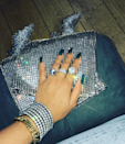 <p>Ri's deep green nails add a fun pop of emerald to her all blue-and-diamond outfit. </p>