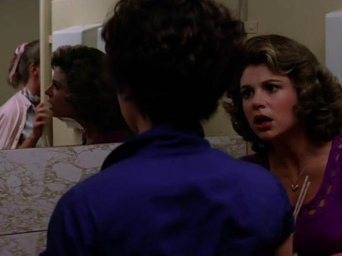 rizzo looking in the mirror in a bathroom