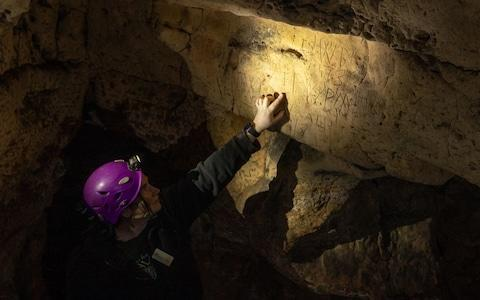 Rare protection marks were found scribed onto the cave surface - Credit: Charlotte Graham