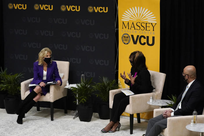 First lady Jill Biden, left, listens to speakers during a forum at the Massey Cancer center at Virginia Commonwealth University for a discussion about cancer disparities. in Richmond, Va., Wednesday, Feb. 24, 2021. (AP Photo/Steve Helber)