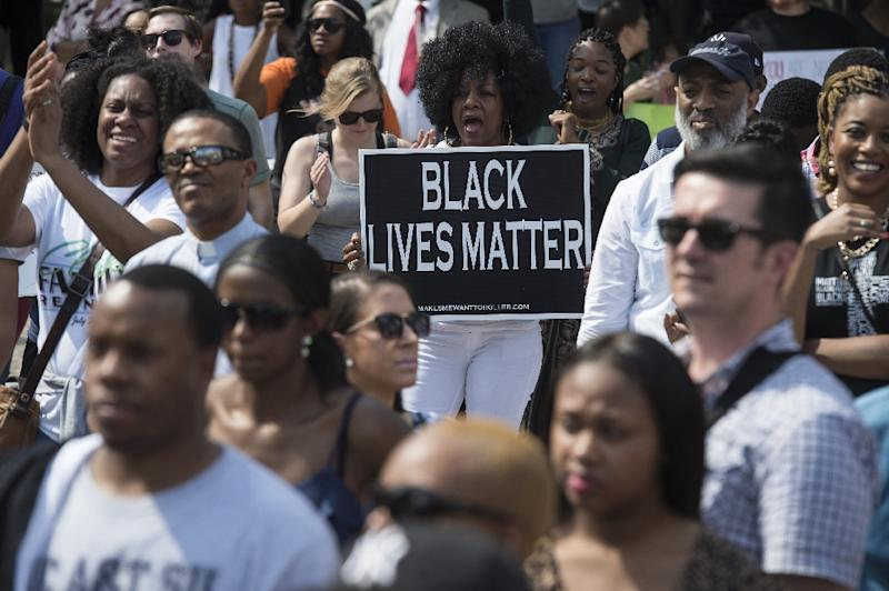 People gather for a rally outside City Hall in Baltimore, Maryland, on May 3, 2015 in a call for peace following widespread riots (AFP Photo/Nicholas Kamm)