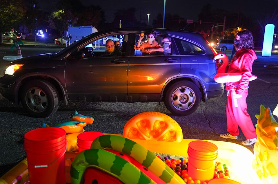 """Families attend a drive-through pool party event to promote Jeff Kinney's latest kids book, """"Diary of A Wimpy Kid: The Deep End"""" on Oct. 26. in Silver Spring, Maryland."""