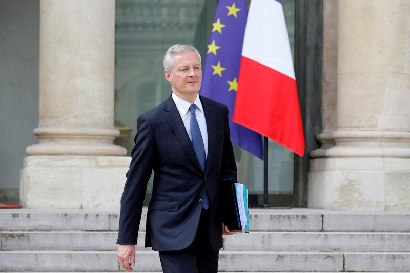 FILE PHOTO: French Finance Minster Bruno Le Maire leaves a cabinet meeting at the Elysee Palace