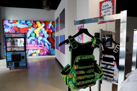 """Bullet proof vests are seen as part of an art installation by artist WhIsBe titled """"Back to School Shopping"""" to illustrate the dangers of gun violence in schools, at a gallery in New York City"""