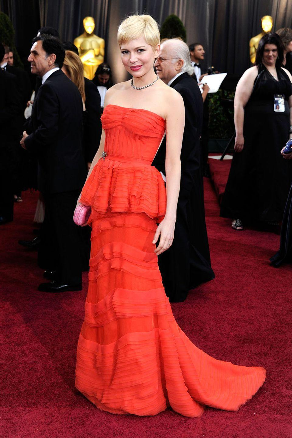 <p>Nominated for Best Actress for <em>My Week With Marilyn, </em>Michelle Williams brought the peplum back in this red tulle Louis Vuitton gown and matching lip. </p>