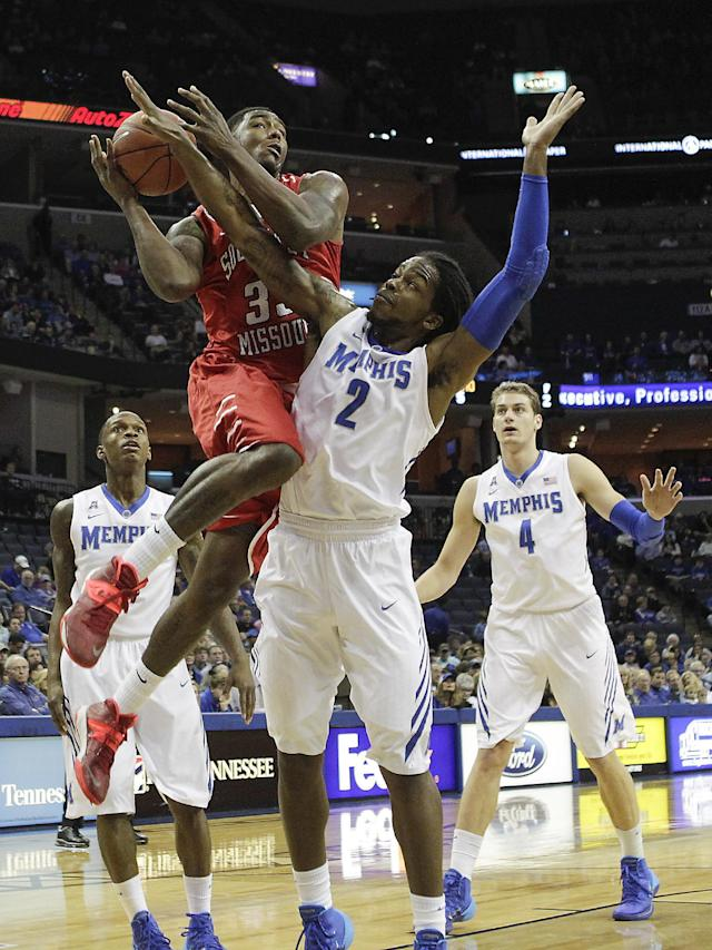 Southeast Missouri forward Tyler Stone (33) goes to the basket against Memphis defenders Joe Jackson (1), Shaq Goodwin (2) and Austin Nichols (4) in the first half of an NCAA college basketball game on Saturday, Dec. 21, 2013, in Memphis, Tenn. (AP Photo/Lance Murphey)