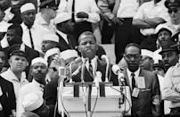 """<p>Twenty-three-year-old <a href=""""https://www.townandcountrymag.com/society/politics/a32767295/john-lewis-philanthropy/"""" rel=""""nofollow noopener"""" target=""""_blank"""" data-ylk=""""slk:John Lewis delivered a rousing speech to spectators"""" class=""""link rapid-noclick-resp"""">John Lewis delivered a rousing speech to spectators</a> as chairman of the Student Nonviolent Coordinating Committee (SNCC). </p>"""