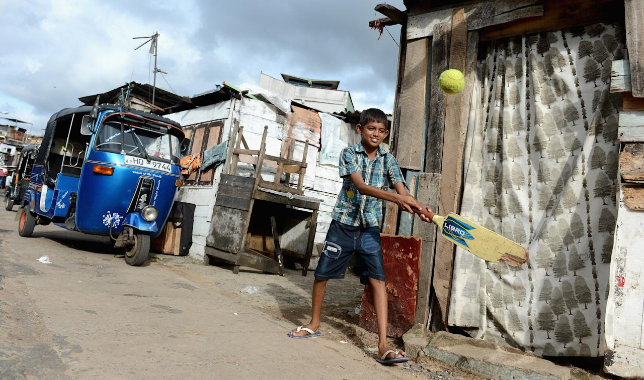COLOMBO, SRI LANKA - SEPTEMBER 23:  Local children play cricket on the streets outside the R. Premadasa Stadium ahead of the ICC World Twenty20 2012 Group A match between England and India at R. Premadasa Stadium on September 23, 2012 in Colombo, Sri Lanka.  (Photo by Gareth Copley/Getty Images)