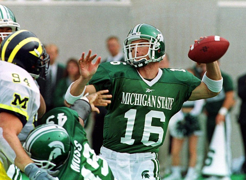 Michigan State quarterback Bill Burke (16) prepares to thrown downfield during the second quarter against the University of Michigan at Spartan Stadium in East Lansing, Mich., Saturday, Oct. 9, 1999. Burke passed for 400 yards and two touchdowns as the No. 11 Spartans held off third-ranked Michigan 34-31 in their showdown of Big Ten unbeatens.