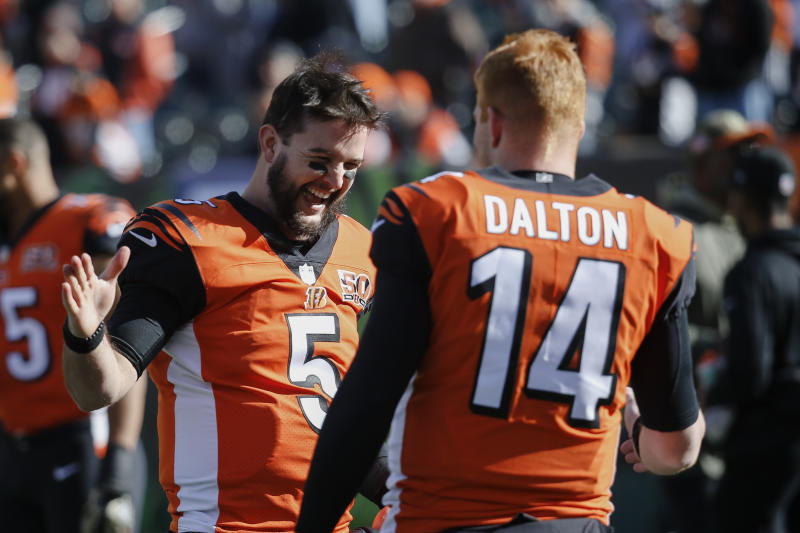 Cincinnati Bengals quarterback AJ McCarron (5), wih quarterback Andy Dalton (14), can become a free agent after winning a grievance. (AP)