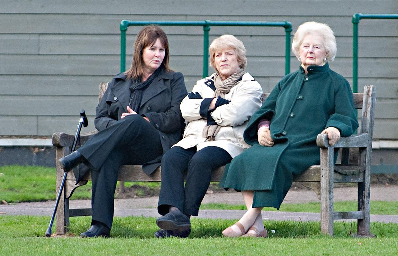 LONDON, ENGLAND - MARCH 08:  (UK PAPERS OUT FOR 24 HOURS FROM 8 APRIL 2013) Former British Prime Minister Baroness Margaret Thatcher spends an afternoon watching school children playing football in Battersea Park with her carer and housekeeper Kate (C) on March 3, 2013 in London, England.  (Photo by Antony Jones/UK Press via Getty Images)