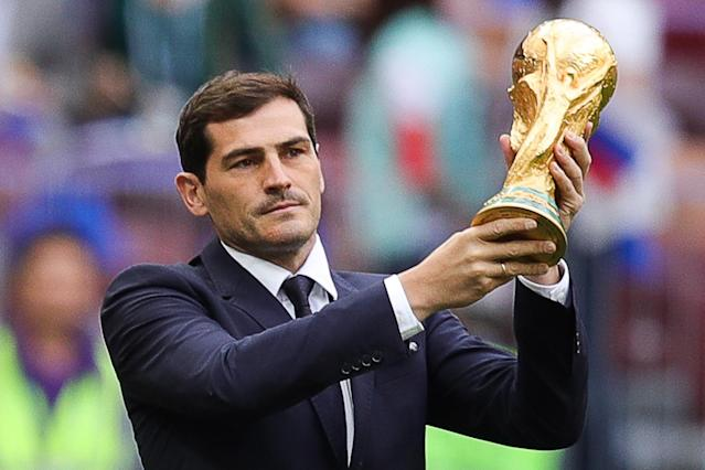 <p>Spanish legend Iker Casillas holds the 2018 FIFA World Cup trophy aloft before kick off. (Getty) </p>