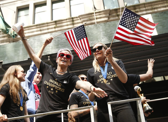 USWNT members Megan Rapinoe and Allie Long are seen during the U.S. Women's National Soccer Team Victory Parade on July 10, 2019 in New York City. (Photo by Brian Ach/WireImage)