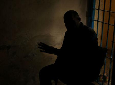 Drug dealer gestures during an interview with Reuters at a Hamas-run prison in Gaza City
