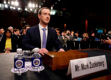FILE PHOTO: Facebook CEO Mark Zuckerberg arrives to testify before a Senate Judiciary and Commerce Committees joint hearing regarding the company's use and protection of user data, on Capitol Hill in Washington, U.S., April 10, 2018.   REUTERS/Aaron P. Bernstein/File Photo