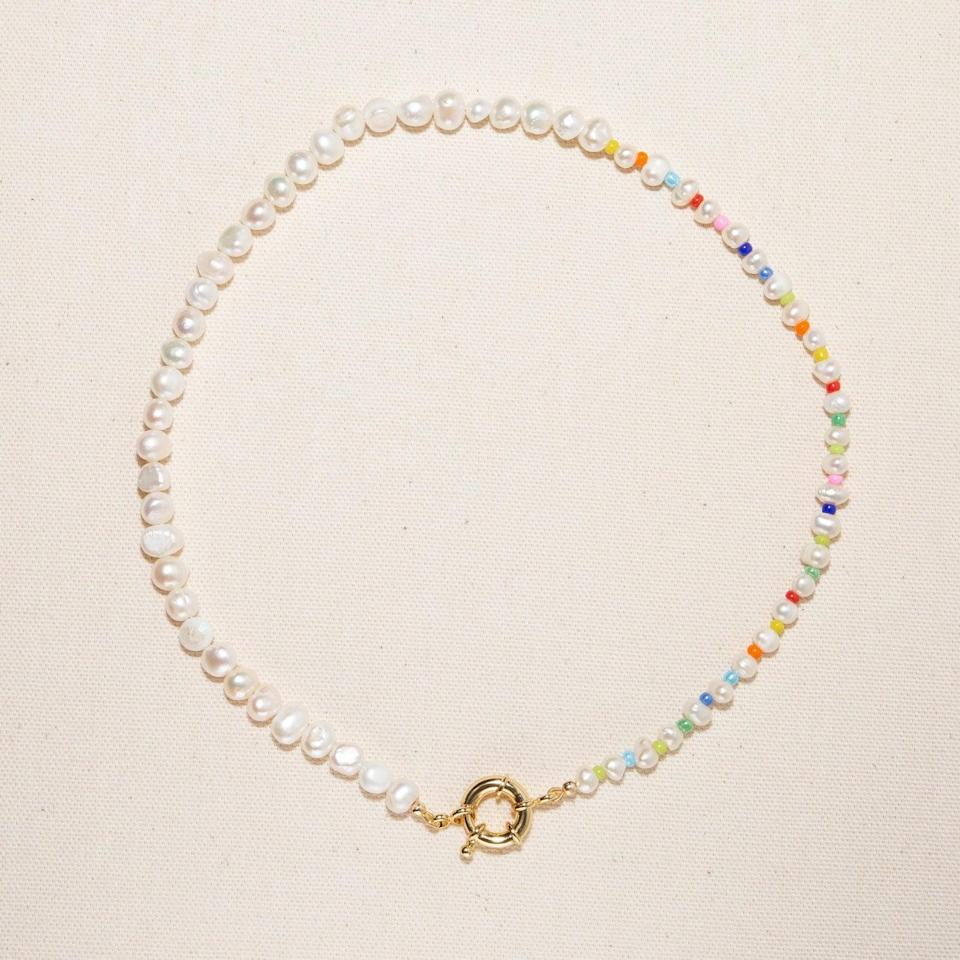 """<p>""""Colorful, beaded necklaces are definitely having a moment, and I'm so glad I decided to hop on the trend with this <span>Freshwater Pearl Pastel Rainbow Necklace</span> ($49). It's the perfect way to add a pop of color to my usual fit of jeans and a white tee."""" - KK</p>"""