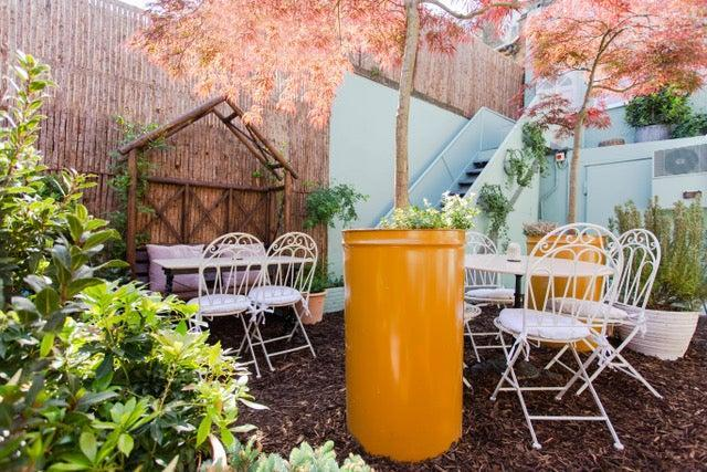 <p>Until now customers would not have gone into the back yard of the 50-cover seasonal-focused Peckham destination, Kudu, because it was the bins area</p> (Kudu)