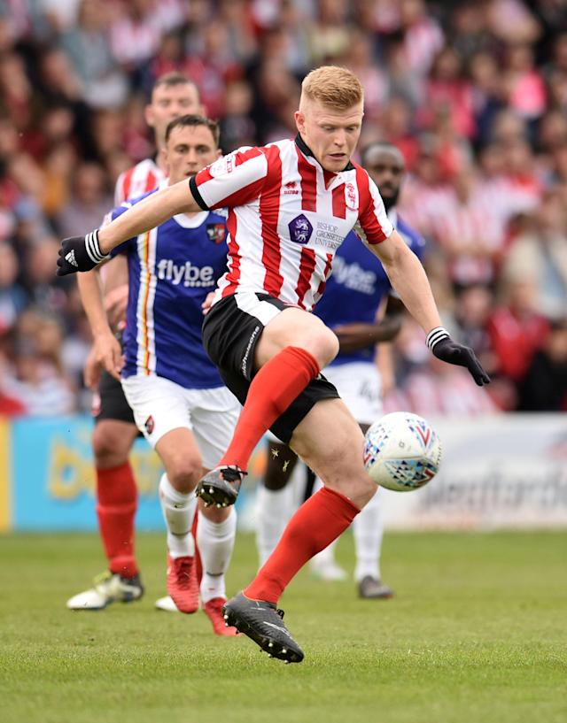 "Soccer Football - League Two Play Off Semi Final First Leg - Lincoln City v Exeter City - Sincil Bank, Lincoln, Britain - May 12, 2018 Lincoln City's Elliott Whitehouse in action Action Images/Paul Burrows EDITORIAL USE ONLY. No use with unauthorized audio, video, data, fixture lists, club/league logos or ""live"" services. Online in-match use limited to 75 images, no video emulation. No use in betting, games or single club/league/player publications. Please contact your account representative for further details."
