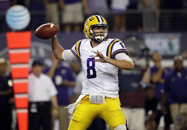 LSU quarterback Zach Mettenberger (8) passes during the first half of an NCAA college football game against the TCU Saturday, Aug. 31, 2013, in Arlington, Texas. (AP Photo/LM Otero)