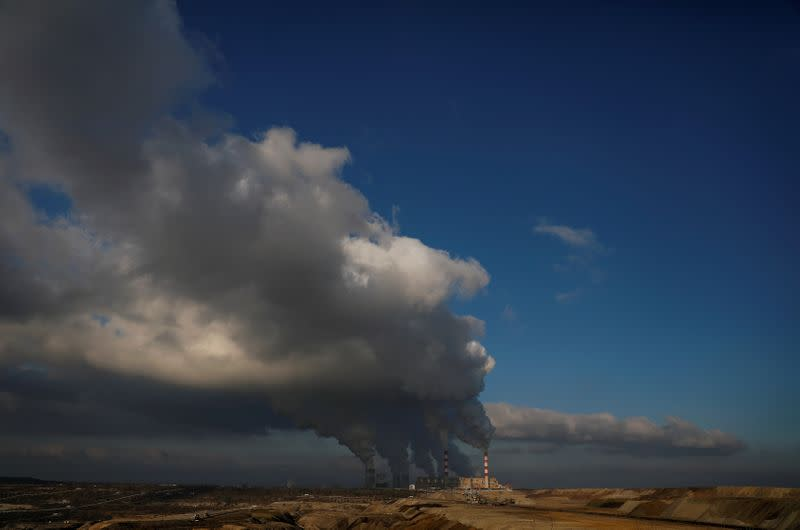 FILE PHOTO: Smoke and steam billows from Belchatow Power Station, Europe's largest coal-fired power plant operated by PGE Group, near Belchatow